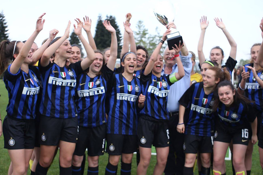 Inter fc women celebrating victory of tournament standing the trophy