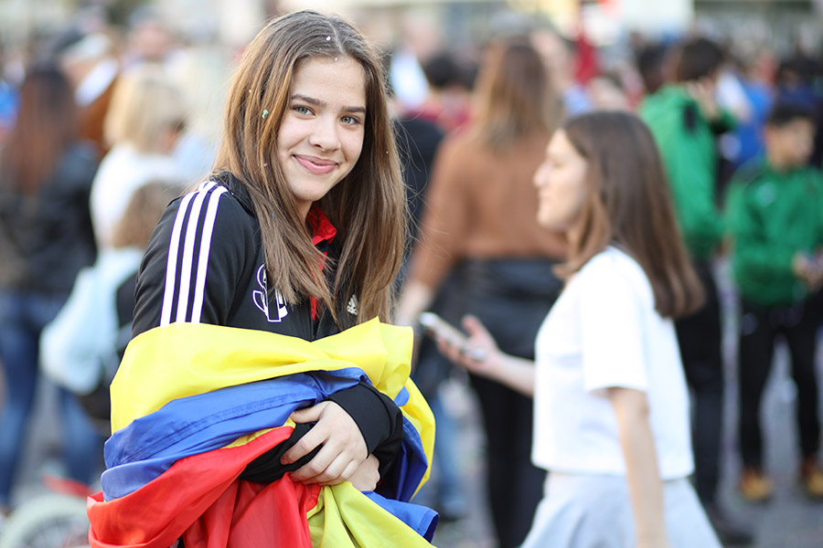 happy college girl with romanian flag