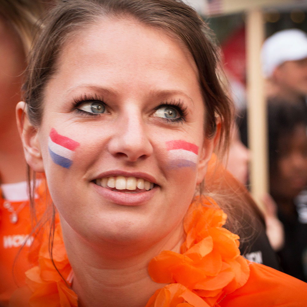 happy dutch girl with flags on the cheeks